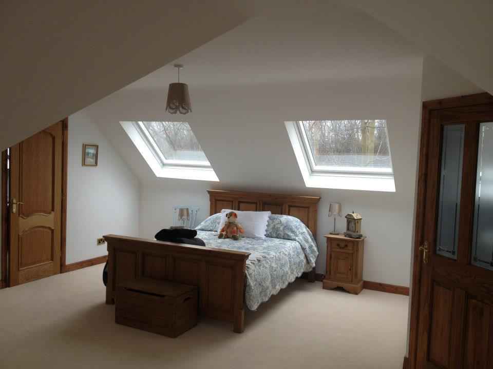 Cottage dormer loft conversion in Saddleworth, creating a large bedroom with Velux windows