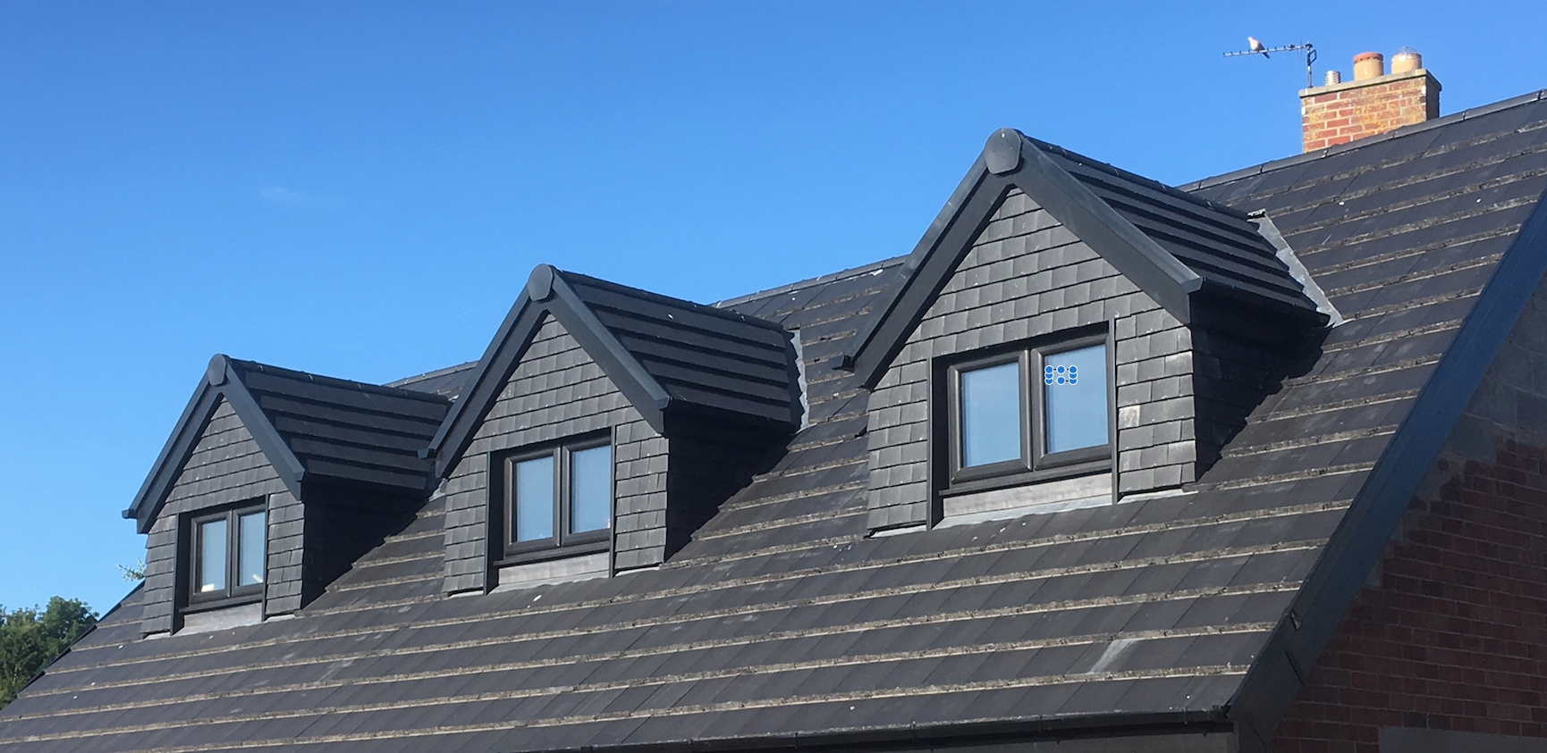 Cottage dormer loft conversion in Lancaster, creating a large bedroom with Velux windows
