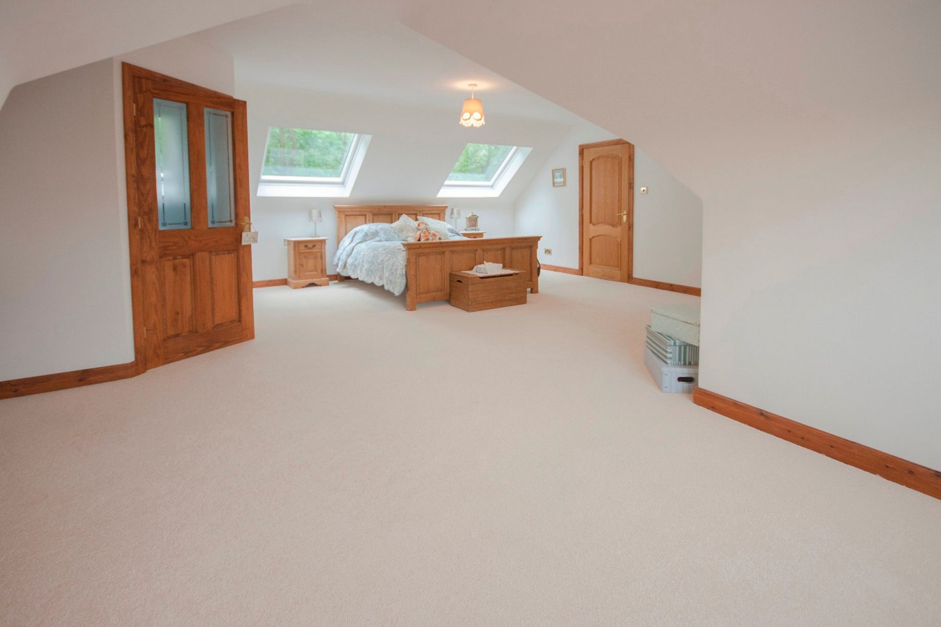 Cottage dormer loft conversion in Thornton-Cleveleys, creating a large bedroom with Velux windows