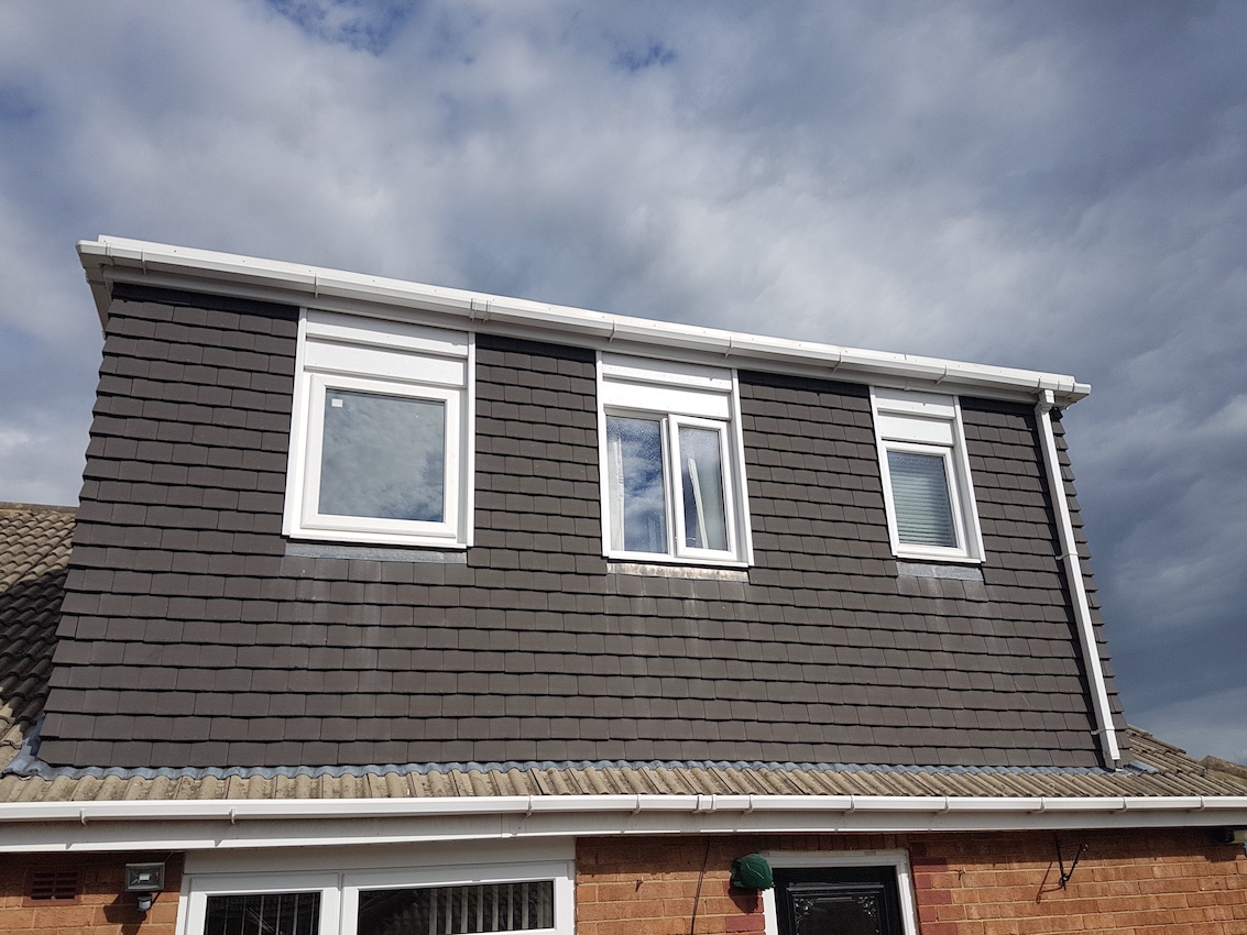 Flat roof rear dormer conversion, creating a master bedroom with bathroom in Lees