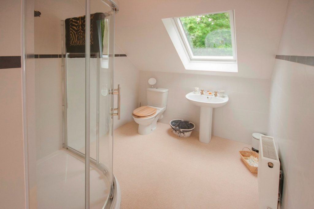 This huge bathroom was undertaken in a Velux loft conversion in Manchester