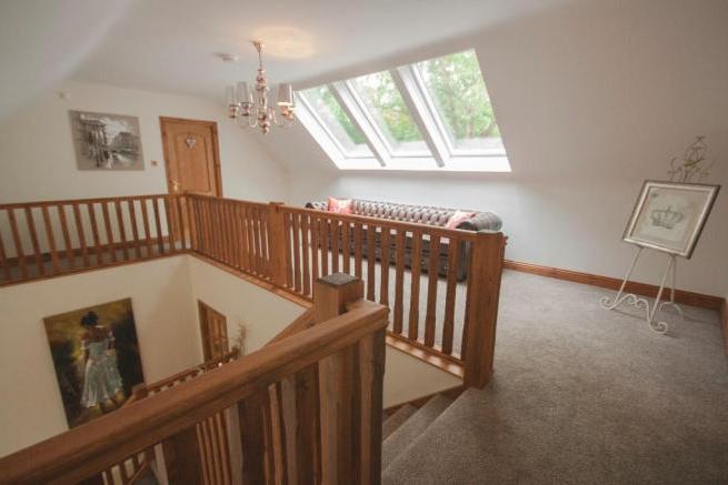 An additinal staircase was introduced on this bungalow loft conversion in Manchester, stunning results were achieved