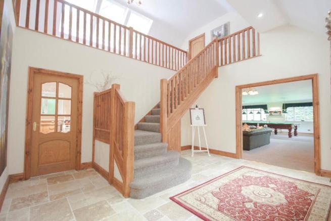 Oak staircase installed in this stunning bungalow, the loft conversion created an extra five bedrooms all with bathrooms