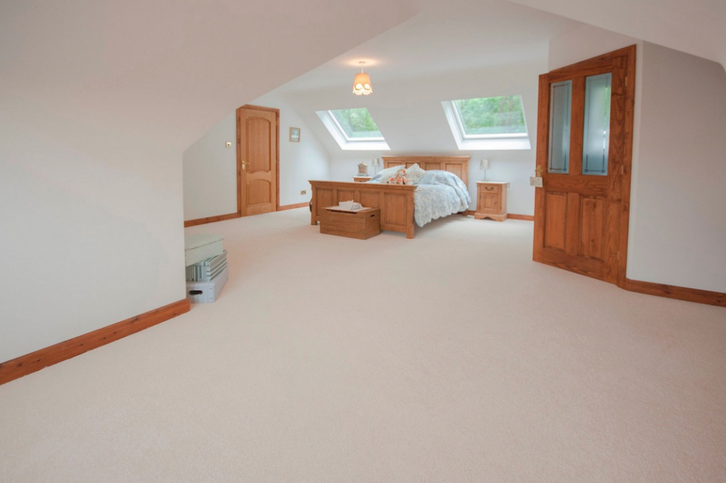 Bungalow loft conversion in Manchester, making this bedroom spacious with a walk in wet room