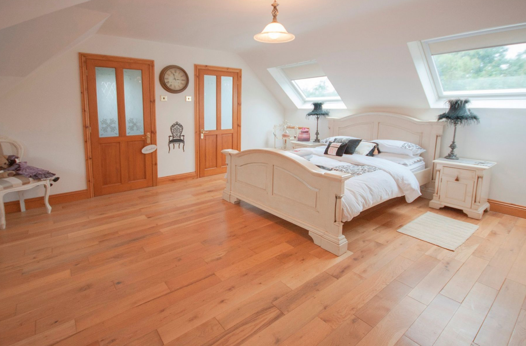 Cottage dormer loft conversion in Reddish, creating a large bedroom with Velux windows