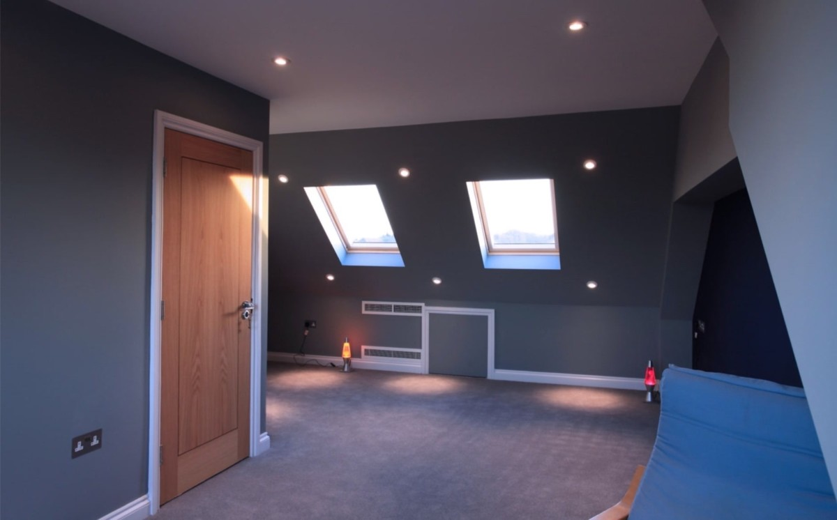 Dormer loft conversion in Seathwaite Way, Accrington, Lancashire BB5 6RB, created two bedrooms with a large bathroom, with Velux roof windows