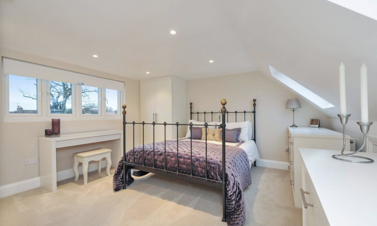 Huge rear dormer loft conversion in Manchester creating a stunning master bedroom with private bathroom, Velux roof windows to the front elevation