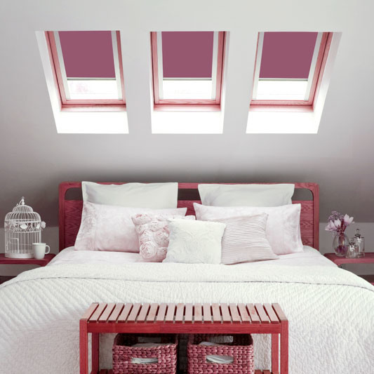Cottage dormer loft conversion in Catforth, creating a large bedroom with Velux windows