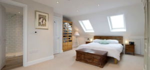 Huge dormer loft conversion in, Prestwich, Manchester master bedroom with private walk in shower.