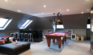 Attic conversion creating games room and bar erea