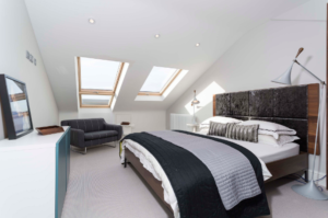 Light and airy Velux loft conversion was started and finished in only four weeks, giving the clients a new stunning bedroom