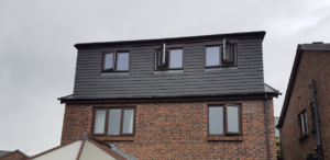 Loft Conversions In Abbey Village - image Rear-dormer-loft-conversion-finished-in-slate-grey-hanging-tile-to-match-the-existing-roof-style-300x146 on https://rafterloftconversions.co.uk