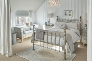 This beautiful Dormer loft conversion created a stunning master bedroom and incorporating a sunken bath in the private bathroom with a walk in wardrobe