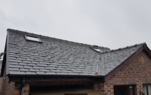 Velux loft conversion, Velux roof windows fitted into a slate roof in Golborne