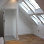 Velux loft conversion with a bank of four windows